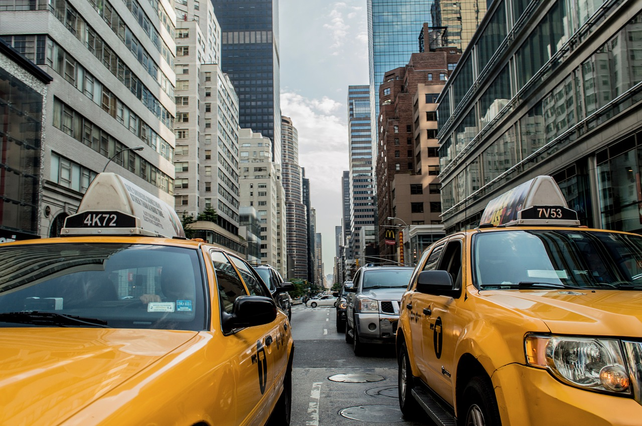 Why travelers choose taxi cabs rather than buses or trains?